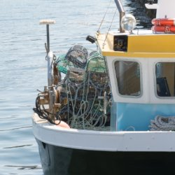Fishing boat, yellow and blue, with gear