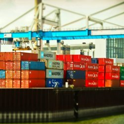 Colourful shipping containers stacked up at a port