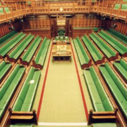 Empty view of House of Commons with green benches on both sides